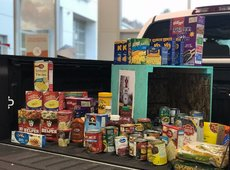 Infant Food Bank Filling Car Seats and Edgar Burton Food Drive