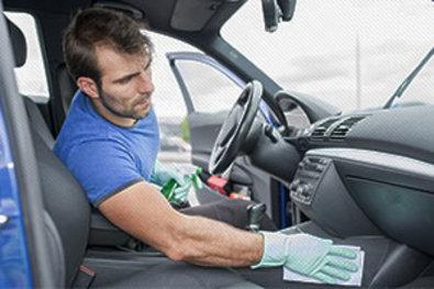 An Automobile Detailing Attendant